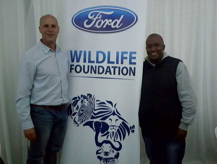 CMH-KEMPSTER-DURBAN-SOUTH-MATTHEW-BUCK-AND-GABRIEL-SITHOLE-STANDING-BY-THE-WILDLIFE-BANNER