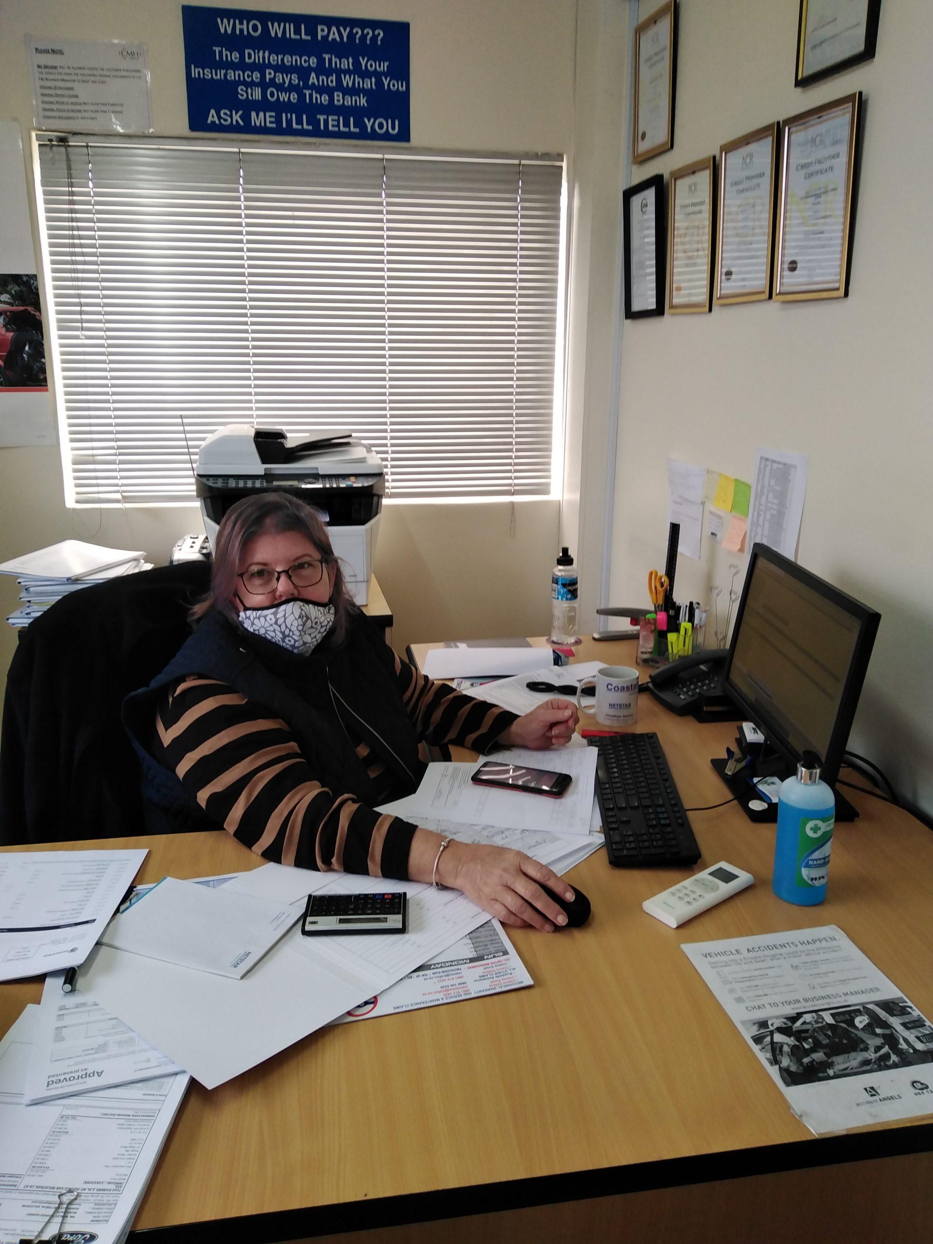 Margret at her desk